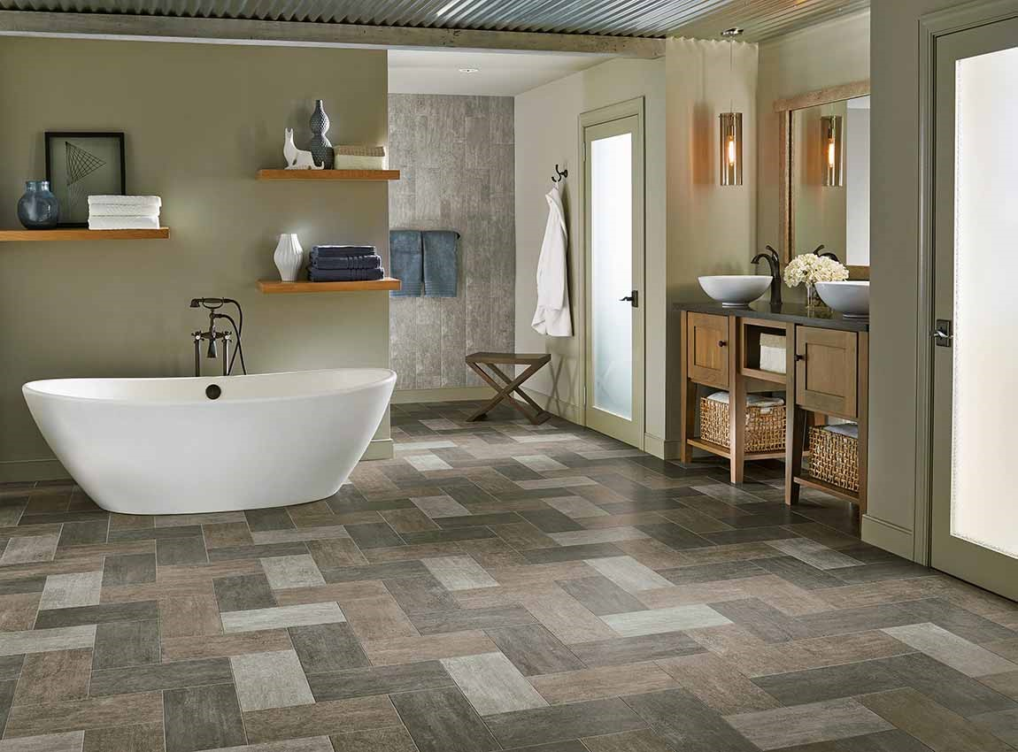 bathroom with pattern tiled flooring and standalone tub